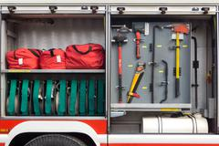 Content fire engine at the bottom of a firefighter in the spring Stock Photos