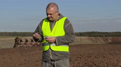 Farmer checked the quality of the soil Stock Footage