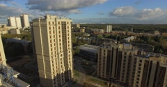 4K aerial construction of multi-storey house residential complex wall hotel Stock Footage