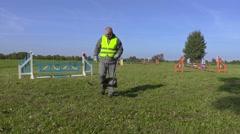 Horse handler maintaining hurdle field Stock Footage