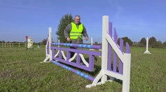 Horse handler with measure tape near hurdle Stock Footage