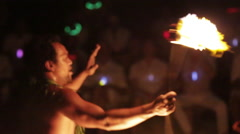 Male fire dancer spins one fire ring and switches hand. Close Up Stock Footage
