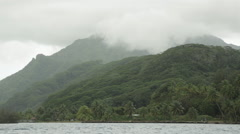 Misty tropical Tahitian coast filmed from moving speed boat Stock Footage