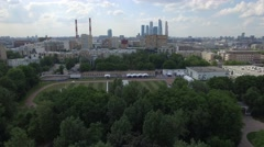 Aerial Athletes involved in sports outside summer Moscow by drone Stock Footage
