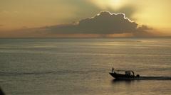 Ship crosses frame underneath a stunning cloudburst sunset - close up Stock Footage
