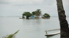 A tiny island with shack, wide zooms into medium shot Stock Footage