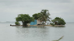 A tiny island with shack and local native Stock Footage