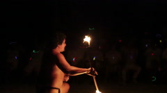 Male fire dancer catches falling flame, performs elaborate juggle, ends show Stock Footage