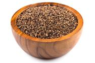 Decorticated cardamom seeds in a bowl Stock Photos