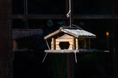 Handcrafted log cabin birdhouse. Close-up Stock Photos