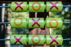 Tic-tac-toe game on the playground Stock Photos