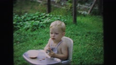 1972: blonde baby kid playing outdoor time happy children LYNBROOK, NEW YORK Stock Footage