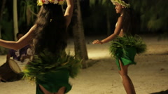 Two native Tahitian hula dancers smile, spin and perform Stock Footage