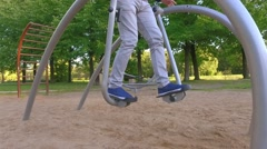 Man exercising in park. Slow motion. Stock Footage