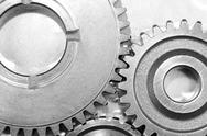Metal cog gears joining together Stock Photos
