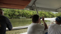 Tourists snap pics from a ferry in the middle of the river Stock Footage
