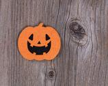Bright scary pumpkin decoration on rustic wooden boards Stock Photos