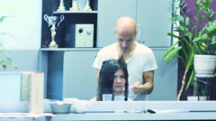 One Italian stylist painted on a woman's hair. close-up shot Stock Footage