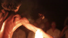 Male fire dancer juggles and throws two spinning fire rings twice - Close Up Stock Footage