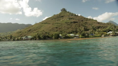 Moorea Island filmed from side of fast moving speed boat Stock Footage