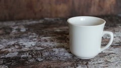 White cup full of coffee beans closeup Stock Footage