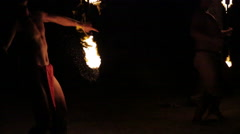 Two male fire dancers create fire rings in tandem Stock Footage