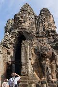 Tourists near South Gate of Angkor Thom from outside the city. UNESCO World H Stock Photos