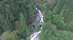 AERIAL SEQUENCE OF TOURSIT - CASCADE WATERFALL AND FOREST RIVER Stock Footage