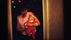 1972: mother is carrying little lad with terrific dress and cap LYNBROOK Stock Footage