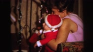 1972: baby in the christmas outfit LYNBROOK, NEW YORK Stock Footage