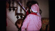 1972: mother sons hanging xmas stocks on staircase LYNBROOK, NEW YORK Stock Footage