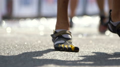 Slow motion of Runners feet on finish line after the marathon Stock Footage