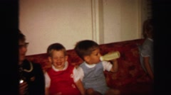 1972: funny and restless kids on the couch with an old woman LYNBROOK, NEW YORK Stock Footage