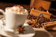 Close-up on star anise and cinnamon sticks with coffee cup Stock Photos