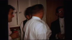 1972: well dressed people gathered in the kitchen at party LYNBROOK, NEW YORK Stock Footage