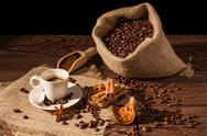 Coffee cup with cinnamon, star anise and dried orange fruit Stock Photos