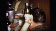 1972: people gathered around table preparing to eat birthday cake LYNBROOK Stock Footage