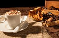 Close-up of coffee cup, dried orange fruit and cinnamon sticks Stock Photos