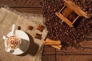 Coffee cup, star anise, cinnamon sticks and coffee beans Stock Photos