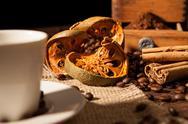 Close-up on dried orange fruit and cinnamon sticks Stock Photos