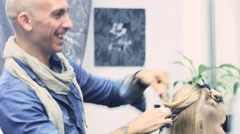 Hairdresser In Action. Barber and customers. hairstyle models for white hair Stock Footage
