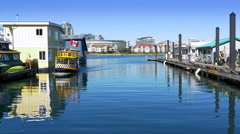4K Harbor Ferry Taxi Sails into Dock past Houseboats, Fishermans Wharf Victoria Stock Footage