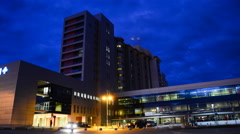 Health Care Modern Hospital Exterior Building at night. 4K Time Lapse Stock Footage