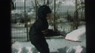 1974: little boys are shoveling the snow LYNBROOK, NEW YORK Stock Footage