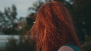 Red hair girl in glasses on motor boat. Beautiful summer evening. Sunset. Smile Stock Footage