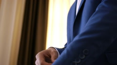 Stylish groom in blue luxury suit wearing cufflinks close up  Stock Footage