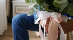 Bride holding a bouquet of bride's hands closeup Stock Footage