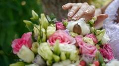 Bride holding wedding bouquet in hands Stock Footage