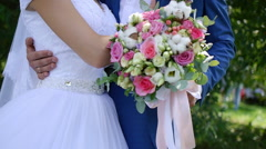 Bride embraces fiance are holding wedding bouquet Stock Footage