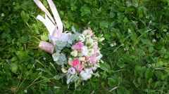Bridal bouquet lying on the grass 4 Stock Footage
